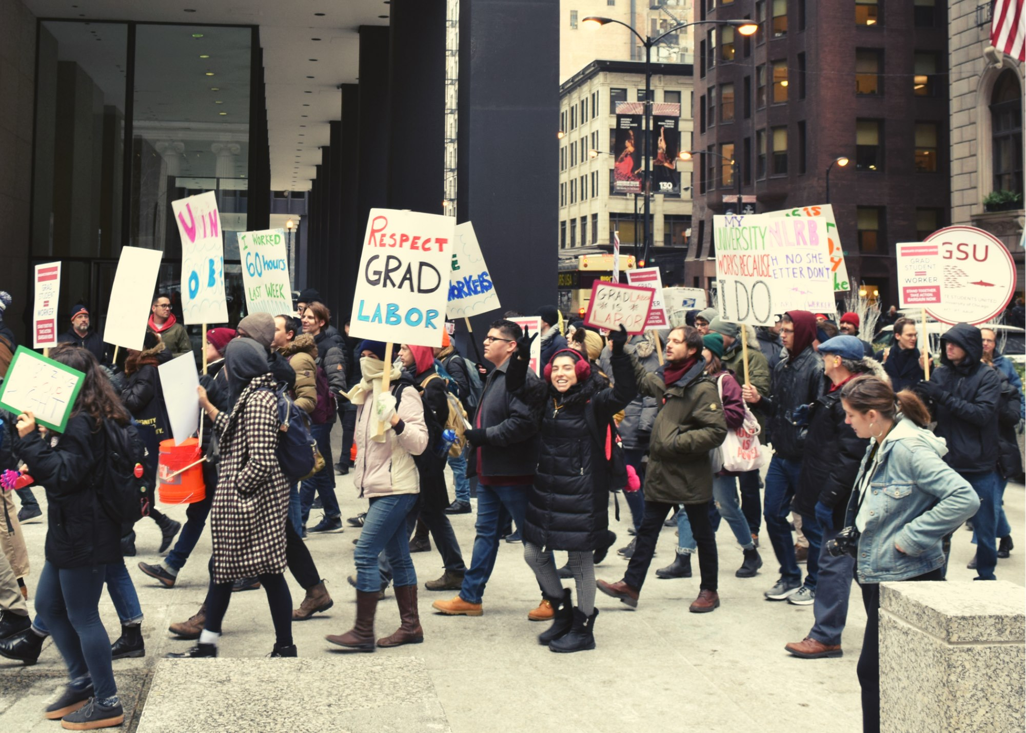 Graduate workers walk in a picket line in downtown Chicago