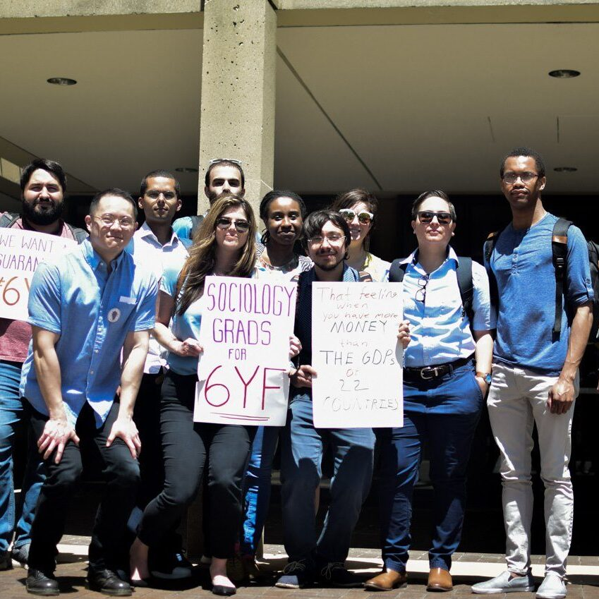 Sociology graduate students at NUGW event stand together